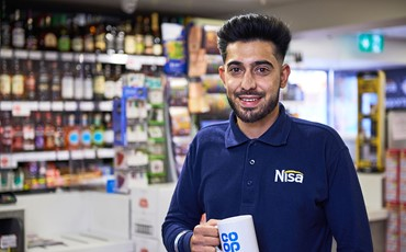 Image - Nisa Employee Stood With Cup