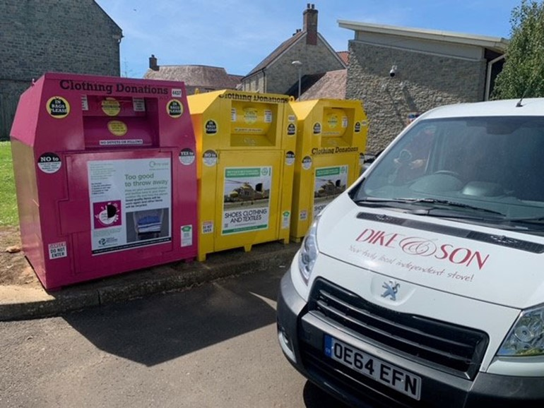Making a Difference Locally launches charity clothing banks MADL pink and yellow banks with van