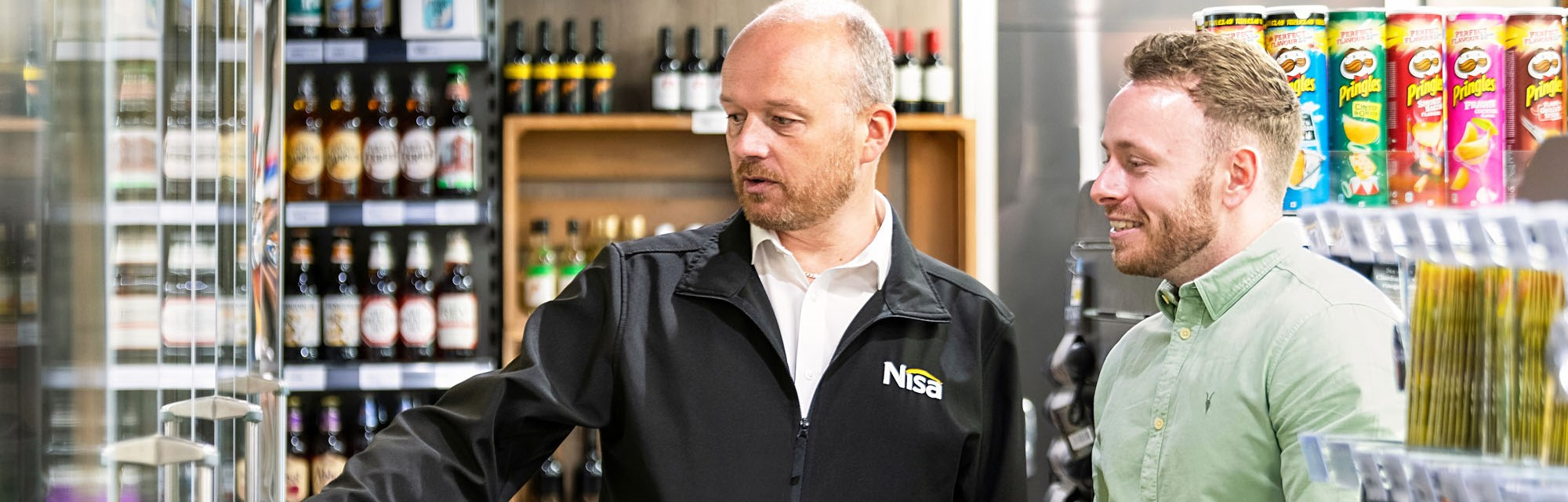 Header - Nisa Local Employees Working Together To Arrange Shelves